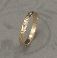 Romance in the Garden Wedding Band or Stacking Ring--Solid 14K Yellow Gold Floral Patterned Ring--Custom Made in YOUR size. $120.00, via Etsy.