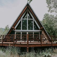 We have a question for you guys. We're debating painting all that white trim the same dark blue as the rest of the cabin. photo by A Frame Cabin, A Frame House, Cabins In The Woods, House In The Woods, Cabana, Cabin Plans, House Plans, Ideas De Cabina, Cabins And Cottages