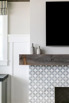 Most up-to-date Totally Free Fireplace Remodel herringbone Style A flat panel television is mounted above a chunky rustic wood fireplace mantle accenting a white an Herringbone Fireplace, Wood Mantle Fireplace, Fireplace Tile Surround, Wood Mantels, White Fireplace, Fireplace Remodel, Fireplace Surrounds, Fireplace Design, Fireplace Ideas