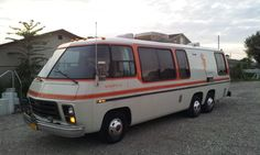 I love the paint job on this one :-) --- 1974 GMC CANYON LANDS  GMC MOTORHOME