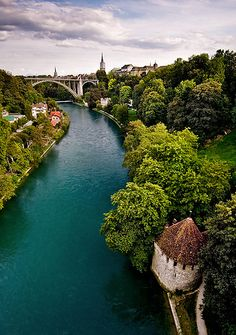 Switzerland - Bern: The Pureness of Blue    A river seperates Bern Old Town from the remainder of the City in Switzerland.    by John & Tina Reid