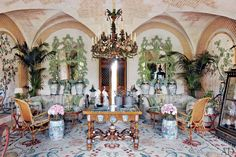 Valentino Garavani's Asian-Inspired Château Near Paris ~ English chinoiserie mirrors from the 1880s flank the marquetry doors; the Dutch center table incorporates delftware accents.
