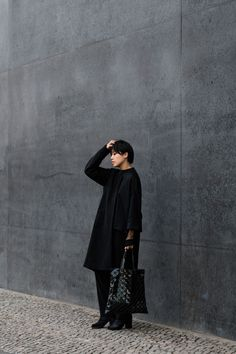 Gentlewoman Look with black wool coat by Martin Margiela, BAO BAO bag by Issey Miyake - Minimalist Style / All Black Everything - IheartAlice.com