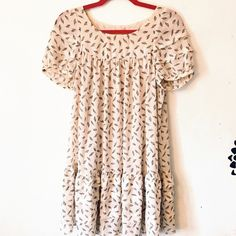 ✨BOGO 50% OFF✨💰⬇️ Feather Patterned Dress (S/M) This knee length dress is absolutely perfect for the upcoming summer and autumn seasons. It comes with its own hand-tied belt that you can see in the pictures of me wearing it above. Very airy and comfortable to wear. Subi Dresses Midi