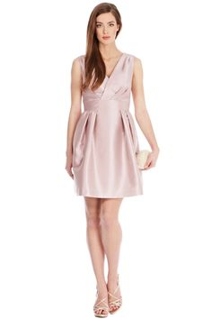 This softly structured dress has a charming edge with functional side pockets for a modern look. The Riley dress features a V-neck with a full skirt that pleats at the waist for a dramatic cocoon silhouette. For a ladylike finish a cute bow is fixed at the back waist complimenting the low V-back cut. This dress is closed with a concealed side zip and is 68cm/25 inches in length from underarm to hem.