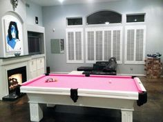 Add some fun to your living room with a pretty pink pool tables. Modern style and tasteful living. Bright, Unique and Colorful Living Room Decorating Ideas.