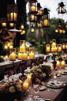 Something enchanting about this colour combo and dining layout. Cluster but plenty of room to move and view.  Combo of low flower arrangements and taller candles