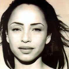 Helen Folasade Adu, a/k/a Sade ---- Very smoooooooth sound.    Click on her pic to view/listen to video for 'No Ordinary Love'. Recorded in 1992.