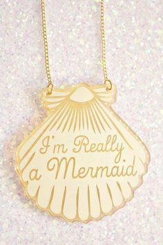 """""""I'm Really a Mermaid"""" gold seashell necklace from Etsy (seller ilovecrafty). Now just find someone wearing it and you'll know it's the real Ariel..."""