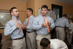 Nautical Wedding, Forked River, NJ.  Latitudes on the River. Photos: Inspire Me Imagery.   Groomsmen suite, tan linen suits, orange gingham ties, charles tyrwhitt shirts, tying ties