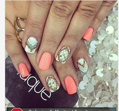 Coral nails with bling
