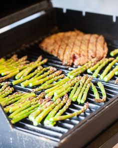 Grill Like an Italian with Colavita: Flank Steak with Pesto over Sun-Dried Tomato Polenta with Asparagus