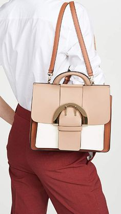 20% off List Price:	$495.00 Price:	$396.00 You Save:	$99.00 (20%) Color: Latte Leather: Calfskin Smooth leather with colorblock design, Can be worn crossbody or as a backpack, Decorative buckle at front Length: 9.75in / 25cm Height: 8.75in / 22cm Sliding clasp closure  shoulder bag beautiful bags favor bags bags for women bag pattern women bags fashion women bags 2019 women bags handbags handbags 2019 trend #bags #handbags #shoulderbags Shoulder Handbags, Shoulder Bag, Favor Bags, Zac Posen, Beautiful Bags, Hermes Kelly, Smooth Leather, Backpacks, Women Bags