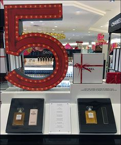 Yes creating a new Point-of-Purchase display year after year after year becomes an ever increasing challenge for a long-lived brand like Chanel. Nevertheless I think I would focus attention on the . Chanel No 5, Point Of Purchase, Visual Merchandising, Close Up, Display, Challenge, Retail, Cosmetics, Inspiration