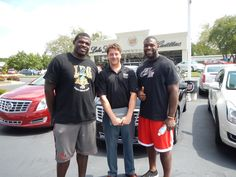 Jacques Smith and James Stone of the Atlanta Falcons with one of our Certified Sales Specialists, Eric Miedema.