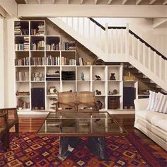 build modular bookshelves beneath the living room stairs