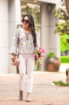 cute & little | dallas petite fashion blog | floral lace-up bell sleeve top, white distressed jeans, rockport total motion perforated bootie, pink tassel earrings | spring outfit