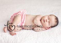 Newborn photo of two week old baby girl with natural light newborn photographer Tara McGlinchey.