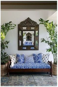 British Colonial Caribbean Decor | blue and white daybed decor with dark wood ornate furniture - always like that touch of blue