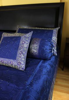 Unique hand embroidered 7-Piece #duvet cover set. Crafted in India. Available in king and queen sizes. Click to shop at Banarsi Designs.