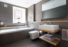 Blissful bathing in a beautiful home in Edinburgh. The owners of this home have cleverly combined a dark grey tile with a warm wood to create a very welcoming and soothing bathing experience. Easy to see why this is a VADO bathroom of the week.