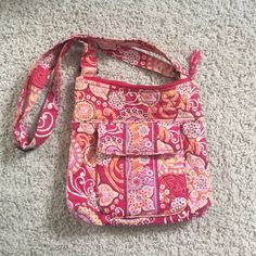Vera Bradley pinks and oranges purse Adjustable strap, nice sized purse with many pockets. Good condition. Not used a lot, it has been stored away in a closet. Vera Bradley Bags Shoulder Bags