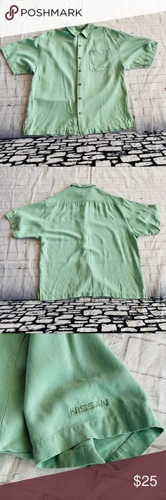 Eagle Dry Goods Co. Women's Silk Top Size XL Eagle Dry Goods Co. 100% Silk women's  Size XL shirt mint green, comes with extra buttons, faux wooden buttons, short sleeved. With Nissan logo on sleeve. Comes with extra buttons. Please refer to pictures.  Length- 27.25 Pit to pit- 24 eagle dry goods co. Tops Button Down Shirts