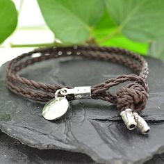 This on trend bracelet features Sterling Silver and braided Leather. The bracelet features a Sterling Silver flower charm and Silver endcaps. The bracelet fastens via a knot and loop closure. The bracelet is also availble in a men's style. See other listings. £18.00