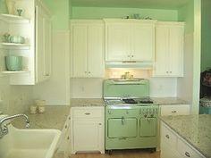 Mint green and white kitchen