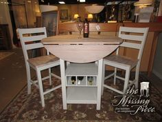 """Drop leaf pub table in an ash gray with light toned top & two barstools. There is wine bottle storage at the base. Super functional set! Perfect for a coastal style home! 40""""rnd x 36""""high, 24""""rnd with leaves down. Arrived: Friday January 13th, 2017"""