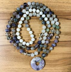 Hand knotted mala necklace with gemstones: moonstone, fluorite, amethyst, labradorite, prenite and mother of pearls Beaded Necklace, Beaded Bracelets, Mother Pearl, Labradorite, Amethyst, Gemstones, Pearls, Jewelry, Beaded Collar