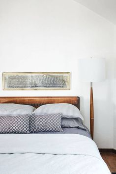 art size / placement in the bedroom, modern living room with texture and print, neutrals, minimalist decor, home, apartment