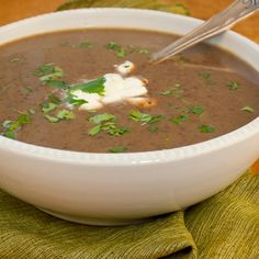 Homemade Black Bean Soup.    Onions, garlic, celery, carrots, 2 cans of black beans, chicken broth.  Combine and puree in a blender, top with cilantro and sour cream - Yummy