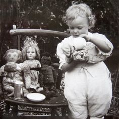 Tea with her Dollies   adorable 1920s photo   via DogDayAfternoons  (and now I am off to get ready for the day! queue on !xo xo )
