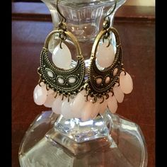 Earrings gold tone with pink beads dangle NWOT Very cute gold tone dangle earrings with pink glass beads. NWOT not to heavy and just a great boho look. Thank u for looking. Jewelry Earrings
