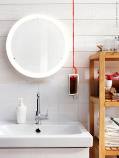 Round IKEA mirror with integrated LED lighting on the wall above the sink. Ikea Bathroom Sinks, Laundry In Bathroom, Bathroom Cabinets, Bathroom Furniture, Bathrooms, Bathroom Mirrors, Ikea Inspiration, Bedroom Inspiration, Ikea Dorm