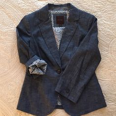 Chambray Blazer from The Limited ✨NWOT unworn blazer by The Limited. Material is 100% cotton chambray in medium blue (color is a bit lighter than shown in the photos).  Two slash front pockets.  Long sleeves.  Full fun-patterned lining is 100% poly.  Excellent condition!  Sorry,NO trades. The Limited Jackets & Coats Blazers