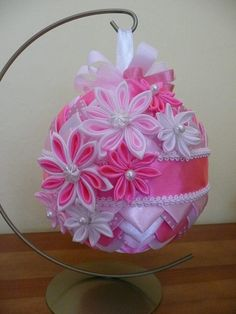 ornament using folded ribbon and ribbon flowers (sold)