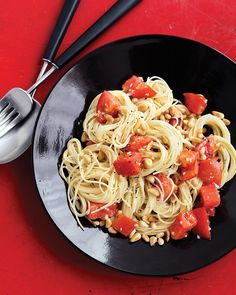 Tomatoes and pasta - This is one of my go to lazy meals. I add more herbs and use fresh hothouse tomatoes. I have never used the pine nuts but they sound good. I also tend to use linguine noodles or spaghetti noodles instead.