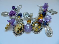 Christian Catholicholy medal Madonna handmade beaded charm bracelet Thissilverplated chain link bracelet has two ornate framed glass tile cabochon pendants with images of our Holy Mother the Virign Mary.  There are oxidized holy medals from Italy and purpleand gold handmadebeaded charms The religious medals are as follows: