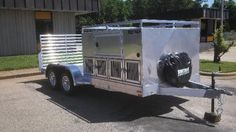 8 dog/ ATV trailer, storage, lights, and a ramp