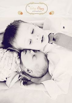 a sweet newborn photo big brother picture baby girl
