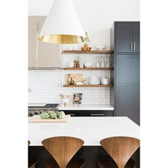 Beautiful black white and wood kitchen: floating walnut open shelving, wood counter stools, white counters, black cabinets - modern kitchen design with warmth and rustic touches Kitchen Decor Home Decor Kitchen, New Kitchen, Home Kitchens, Kitchen Wood, Kitchen Cabinets, Kitchen Ideas, Farmhouse Kitchens, Modern Farmhouse, Kitchen Shelves