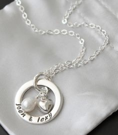 Handmade sterling necklace: Eternity circle with puffed heart and freshwaterpearl. Handstamped with names, words or dates of your choice.