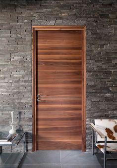 Flush horizontal grain wood door creates the focus juxtaposed with the stone wall and the cow skin leather chair. & Snickarper Modern Doors | Design design Design and Front doors Pezcame.Com