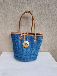 SALE Woven sisal basket, Boho bag, Handmade bag, Tribal basket, Toy storage basket, Picnic basket, Beach bag, Tribal bag, Kenyan kiondo b #PicnicBasket #MarketBasket #GiftForHer #ToyStorage #ShoppingBasket #AfricanBasket #ChristmasGift #BeachBag #SisalWovenBasket #WovenBasket Handmade Bags, Handmade Items, Toy Storage Baskets, Tribal Bags, Picnic Bag, Market Baskets, Leather Weaving, Christmas Gifts For Her, Sisal