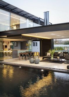 Modern outdoor living room with swimming pool and recessed ceiling light