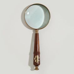 """One of my favorite discoveries at WorldMarket.com: Wood and Brass Anchor Magnifying Glass 10.25""""L x 4""""Dia."""