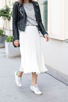 Leather jacket, midi skirt and white sneakers.
