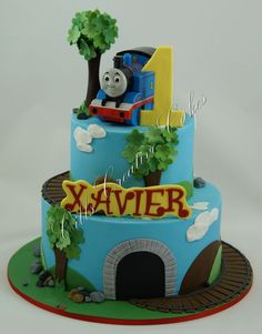 All hand made except for the Thomas toy used for a topper at the customers request.
